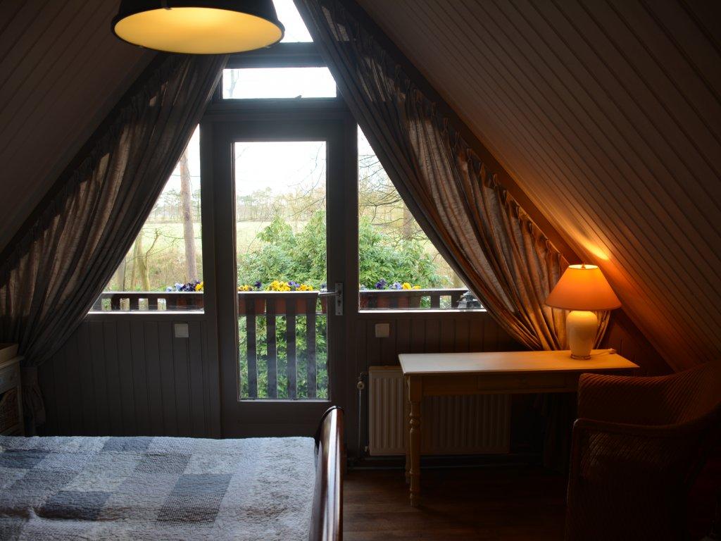 Slaapkamer boven met balkon